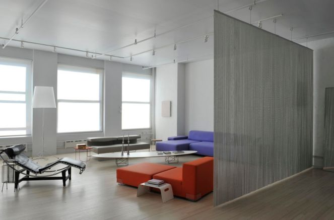 Artist-loft-room-divider-through-a-metalic-curtain