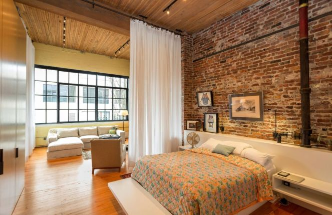 Exposed-bricks-wall-and-curtain-room-divider