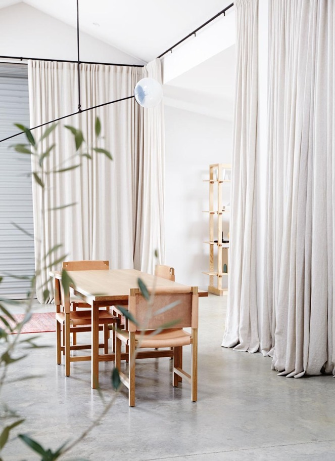 Floor-to-ceiling-divider-curtains-polished-concrete-floor
