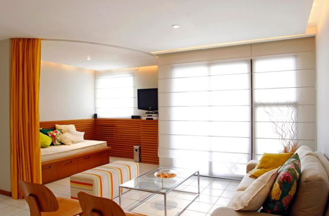 Orange-curtain-used-like-a-room-divider